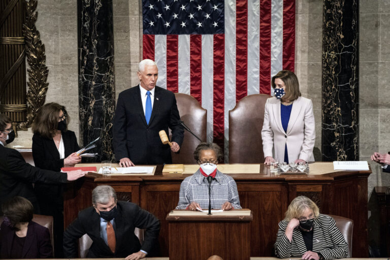 Speaker of the House Nancy Pelosi, D-Calif., and Vice President Mike Pence officiate as a joint session of the House and Senate reconvenes to confirm the Electoral College votes