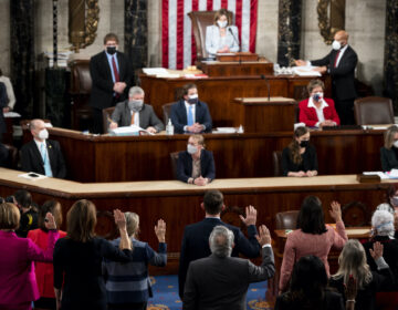 House Speaker Nancy Pelosi administers the oath of office to members of the 117th Congress