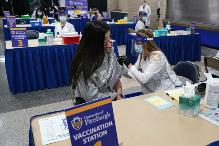 Tiffany Husak receives a COVID-19 vaccine at a vaccination clinic