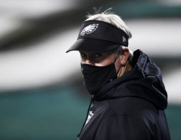 Philadelphia Eagles head coach Doug Pederson walks the field