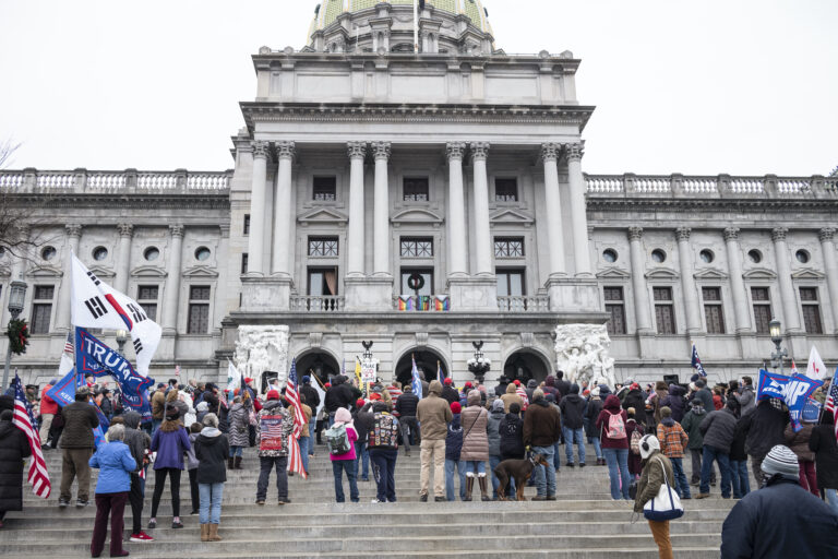 President Donald Trump supporters gather on the statehouse steps as the Pennsylvania House of Representatives are sworn-in