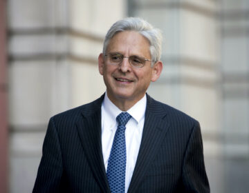Merrick Garland walks into Federal District Court