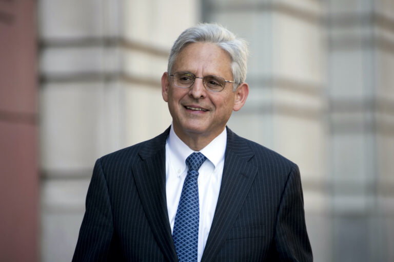 Merrick Garland walks into Federal District Court