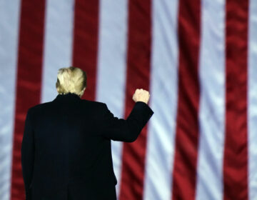 President Donald Trump gestures at a campaign rally