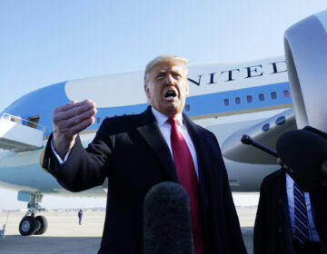 President Donald Trump speaks to the media before boarding Air Force One