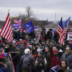 Pro-Trump insurrectionists gather outside the Capitol