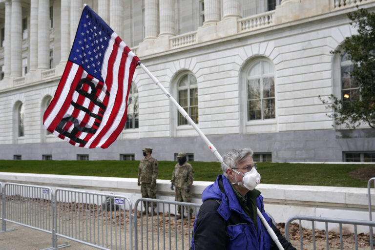 A protester walks past the Russell Senate Office Building on Capitol Hill
