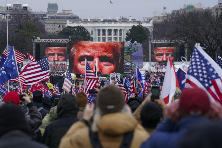 Trump supporters participate in a rally ahead of a violent insurrection at the Capitol building