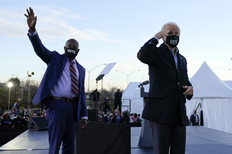 President-elect Joe Biden campaigns in Atlanta, Monday, Jan. 4, 2021, for Senate candidates Raphael Warnock, left, and Jon Ossoff