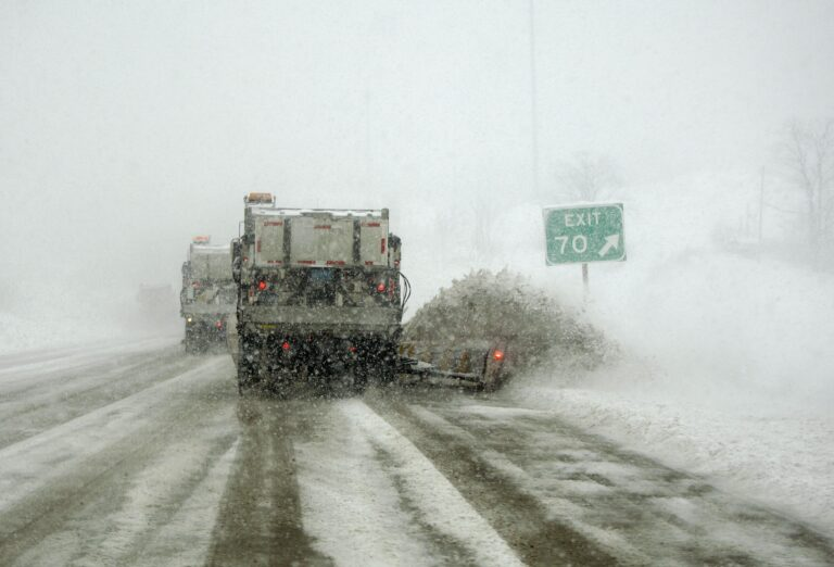 A PennDOT snowplow train works to clear I-91 during a blizzard