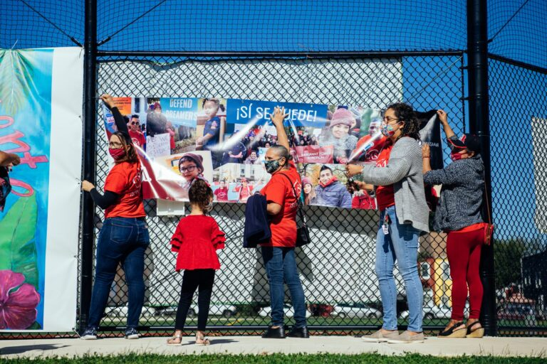 Members of CASA setting up for their event at Roberto Clemente Park in Lancaster on Saturday. (Dani Fresh/WITF)