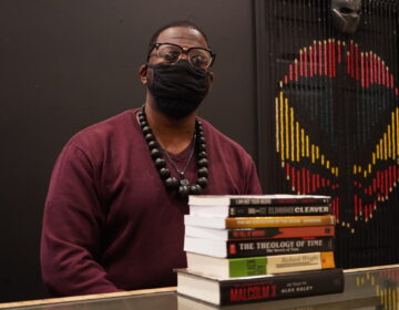 Shaykh Anwar Muhammad, proprietor of Lansdale's Black Reserve Bookstore, recommends anything written by James Baldwin if you are looking to understand America at this moment. (Kenny Cooper/WHYY)