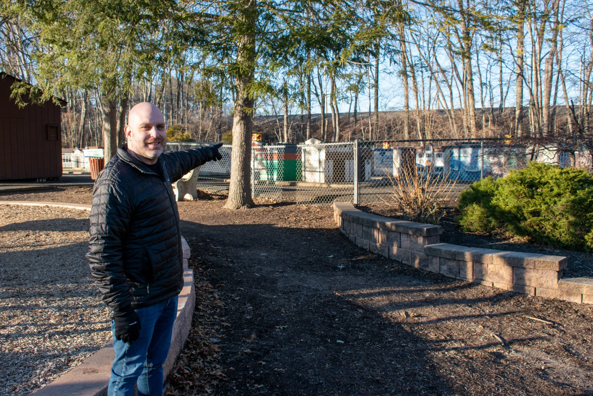 Drew Friedman points to an enclosed area at Mason Mill Park where his son Ari likes to play