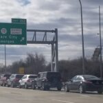 Drivers sit in traffic on the highway while waiting for COVID-19 vaccinations