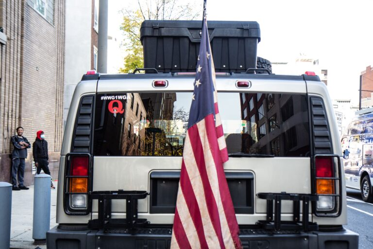 This Hummer was parked near the Pennsylvania Convention Center in November 2020. Inside, police found a semi-automatic rifle, ammunition, a lock-pick kit, among other items. (Kimberly Paynter/WHYY)