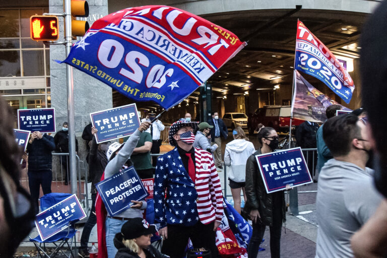 About two dozen protesters gathered outside Philadelphia's vote counting headquarters in support of President Trump