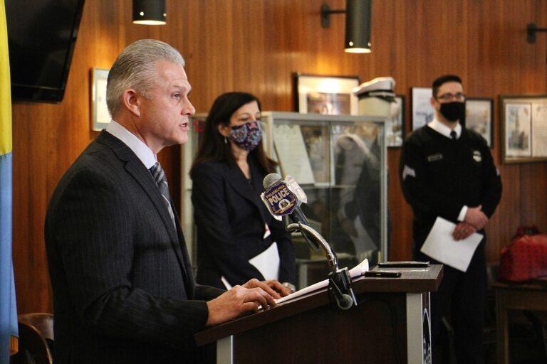 Philadelphia police answer questions about the arrest of Josephus Davis for the murder of a man walking his dog in Brewerytown. From left are Capt. Jason Smith, Assistant District Attorney Joanna Pescatore, and police spokesperson Eric Tripp. (Emma Lee/WHYY)