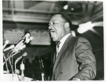 The Rev. Martin Luther King Jr. speaks to a mass rally in Memphis on April 3, 1968, one day before his assassination. (Courtesy of Special Collections Department, University Libraries, University of Memphis Libraries)