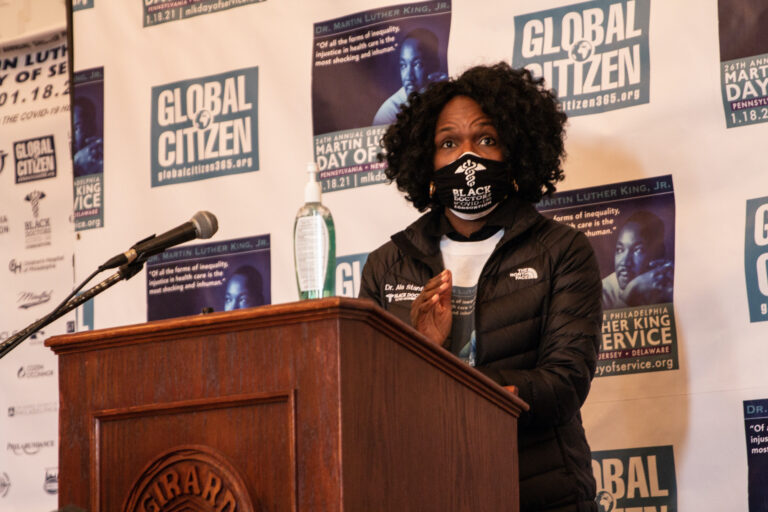 Dr. Ala Stanford speaks at a podium during an MLK Day of Service event