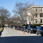 A long line of drivers wait for free COVID-19 testing at Girard College