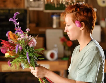 A woman arranging flowers in Movers & Makers Season 3