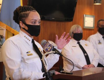 Philadelphia Police Commissioner Danielle Outlaw, wearing a face mask, speaks to the press