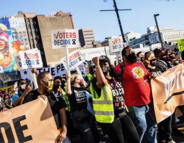 Demonstrators march through Center City Philadelphia to celebrate a Biden win