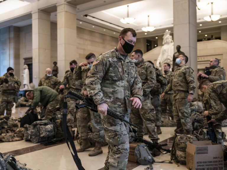 National Guard troops are inside the U.S. Capitol Visitor Center to reinforce security Wednesday at the Capitol in Washington. It comes a week after an insurrection at the Capitol. (J. Scott Applewhite/AP Photo)