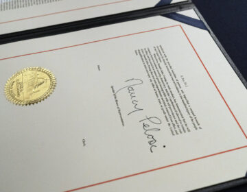 House Speaker Nancy Pelosi's signature is seen on the single article of impeachment against President Trump.
