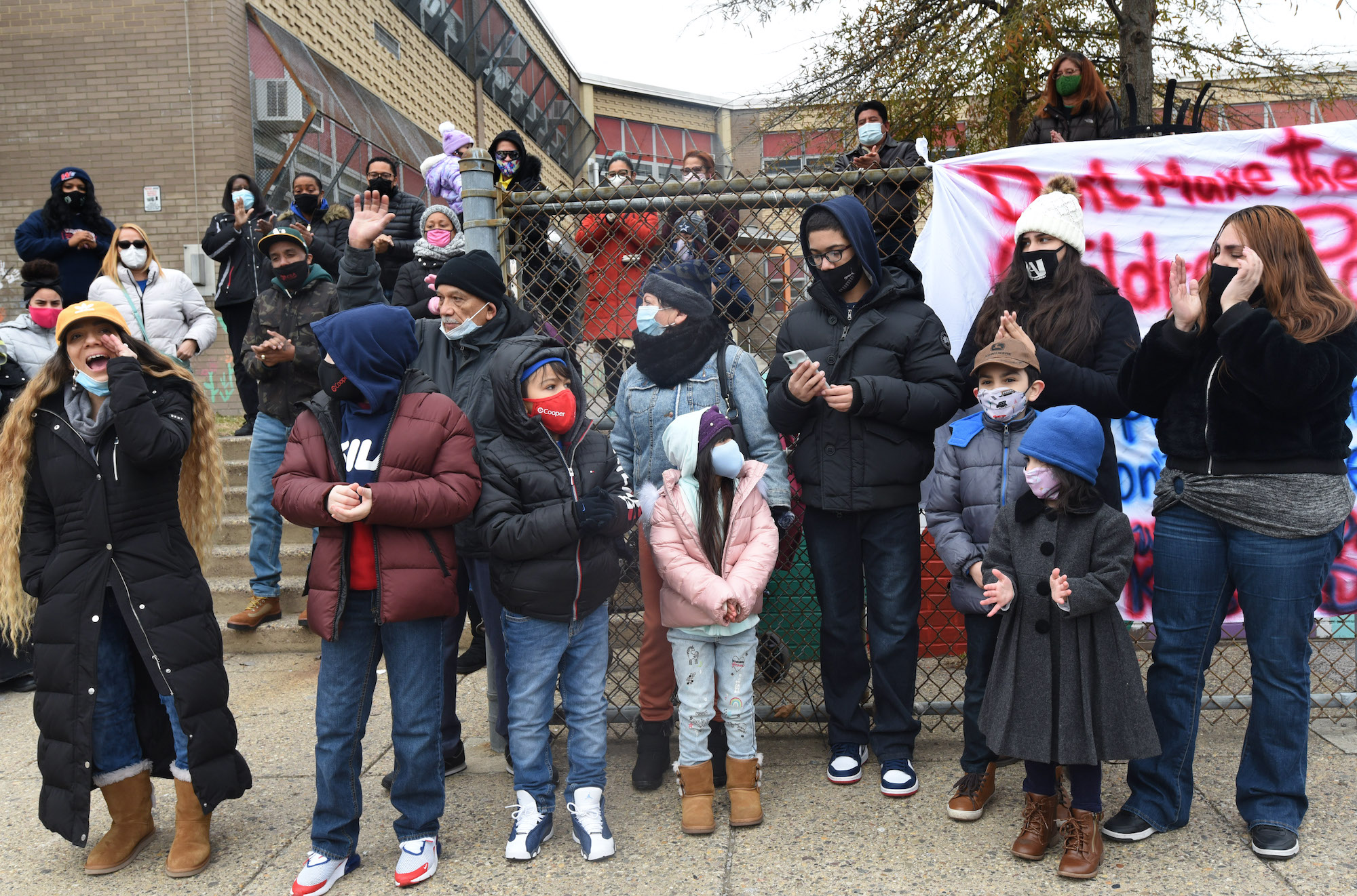 Maria Montero, left, leads a protest against school closures at Wiggins School