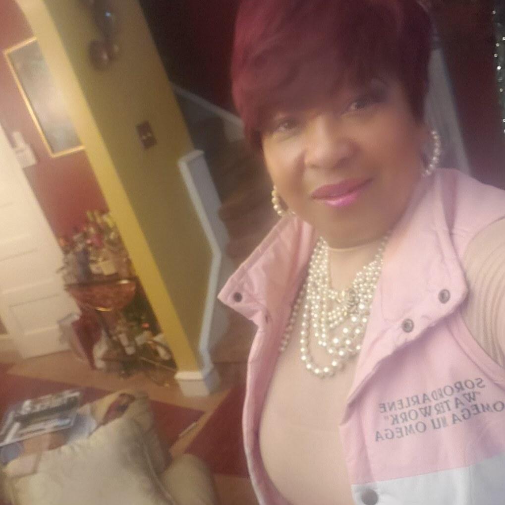Darlene Miller wears an AKA vest and pearls inside her home
