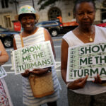 Supporters rallied outside the U.S. Treasury Department in 2019 to demand that American abolitionist Harriet Tubman's image be put on the $20 bill. (Chip Somodevilla/Getty Images)