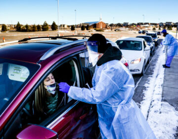 A coronavirus variant that is thought to be more contagious was detected in the United States in Elbert County, Colo., not far from this testing site in Parker, Colo. The variant has been detected in several U.S. states. (Michael Ciaglo/Getty Images)