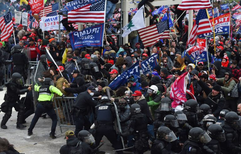 Pro-Trump insurrectionists clash with police and security forces as they push barricades to storm the U.S. Capitol