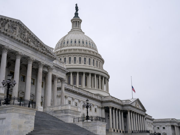 An American Flag flies at half staff at the U.S. Capitol