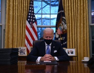 President Biden sits in the Oval Office at the White House