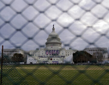 The U.S. Capitol is seen behind fences