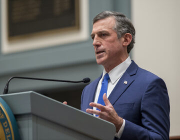 Delaware Gov. John Carney speaks at a podium