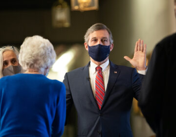 Gov. John Carney takes the oath of office to start his second term in a virtual ceremony held outside his office in Legislative Hall in Dover.