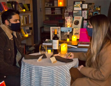 Anush Sridharan and his partner Gina Tomaine chose The Head & The Hand Books to be their first real date out since the pandemic started. (Kimberly Paynter/WHYY)