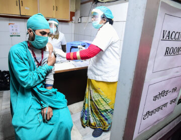 Volunteers and health officials hold a dry run for the coronavirus vaccine at a hospital in Allahabad