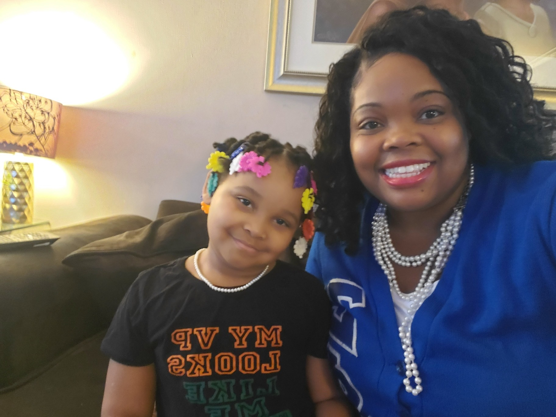 Councilmember Katherine Gilmore-Richardson (right) wears sorority blue and pearls while sitting next to her 6-year-old daughter, Katherine