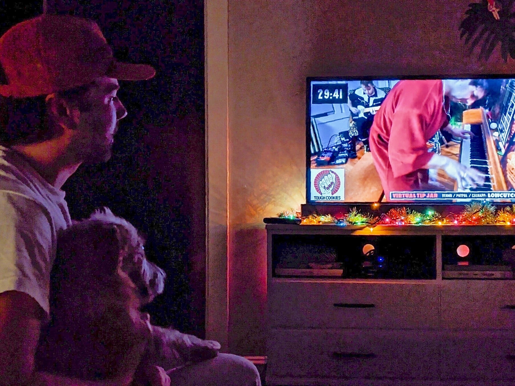 Mike Kaiser and his dog, Rooney, watching a Low Cut Connie livestream concert New Year's Eve.