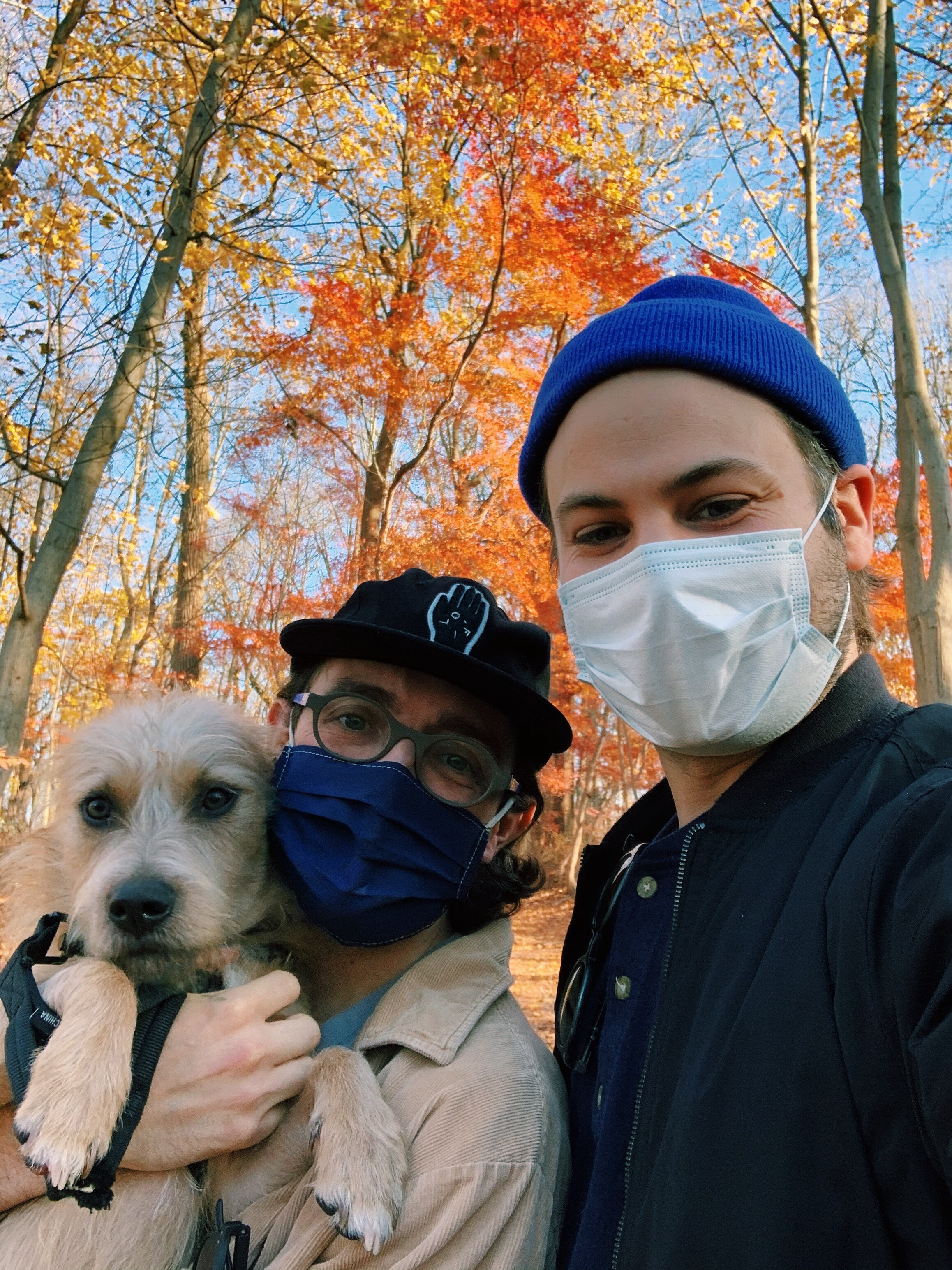 Mike Kaiser and his husband, Wade Keller, and their dog, Rooney, taking a walk at Wissahickon Valley Park.