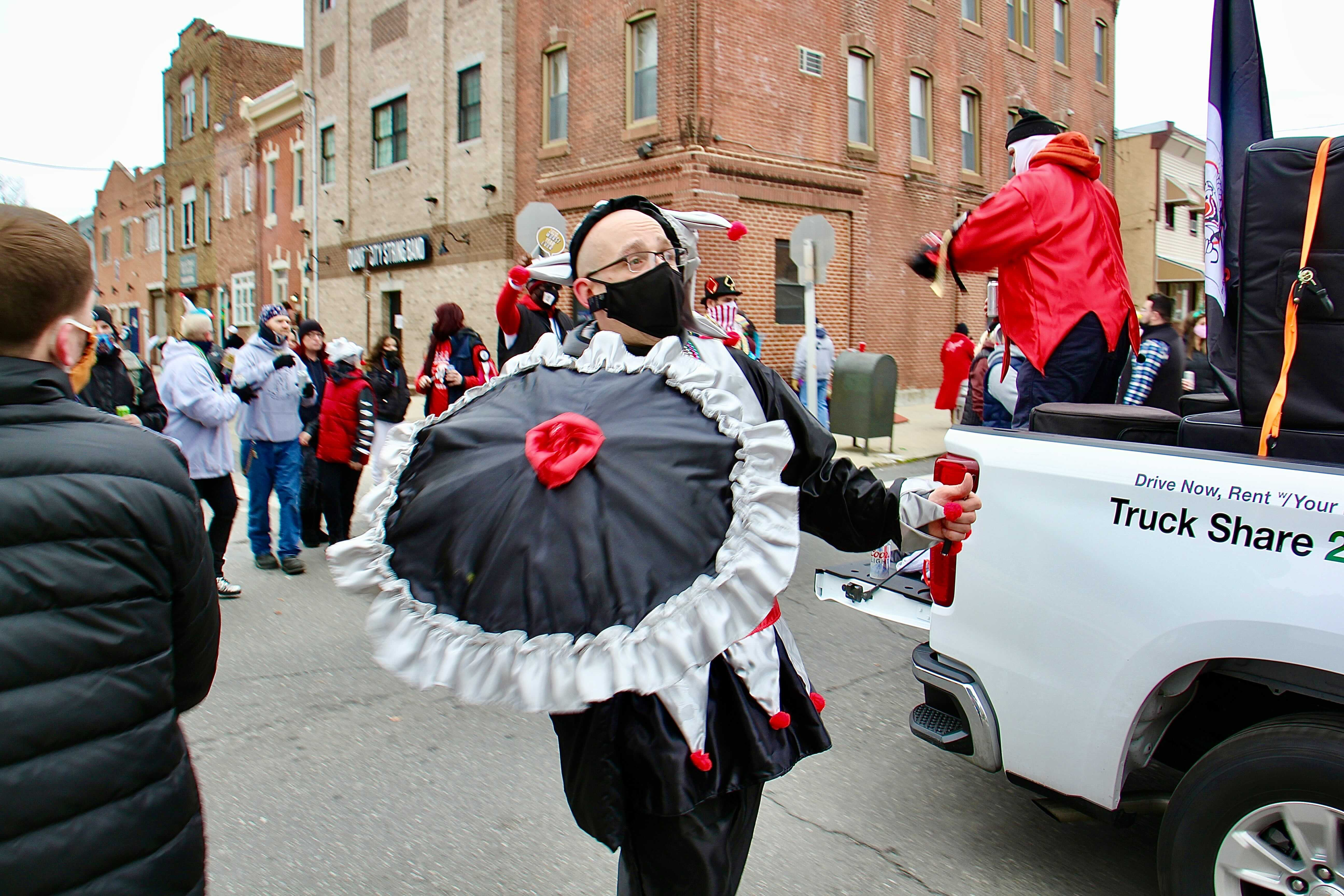 Mummers march on 3rd Street in protest of the cancellation of their annual New Year's Day parade.
