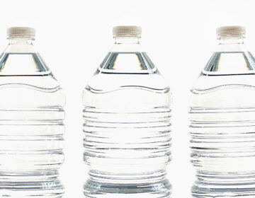 Three plastic water bottles