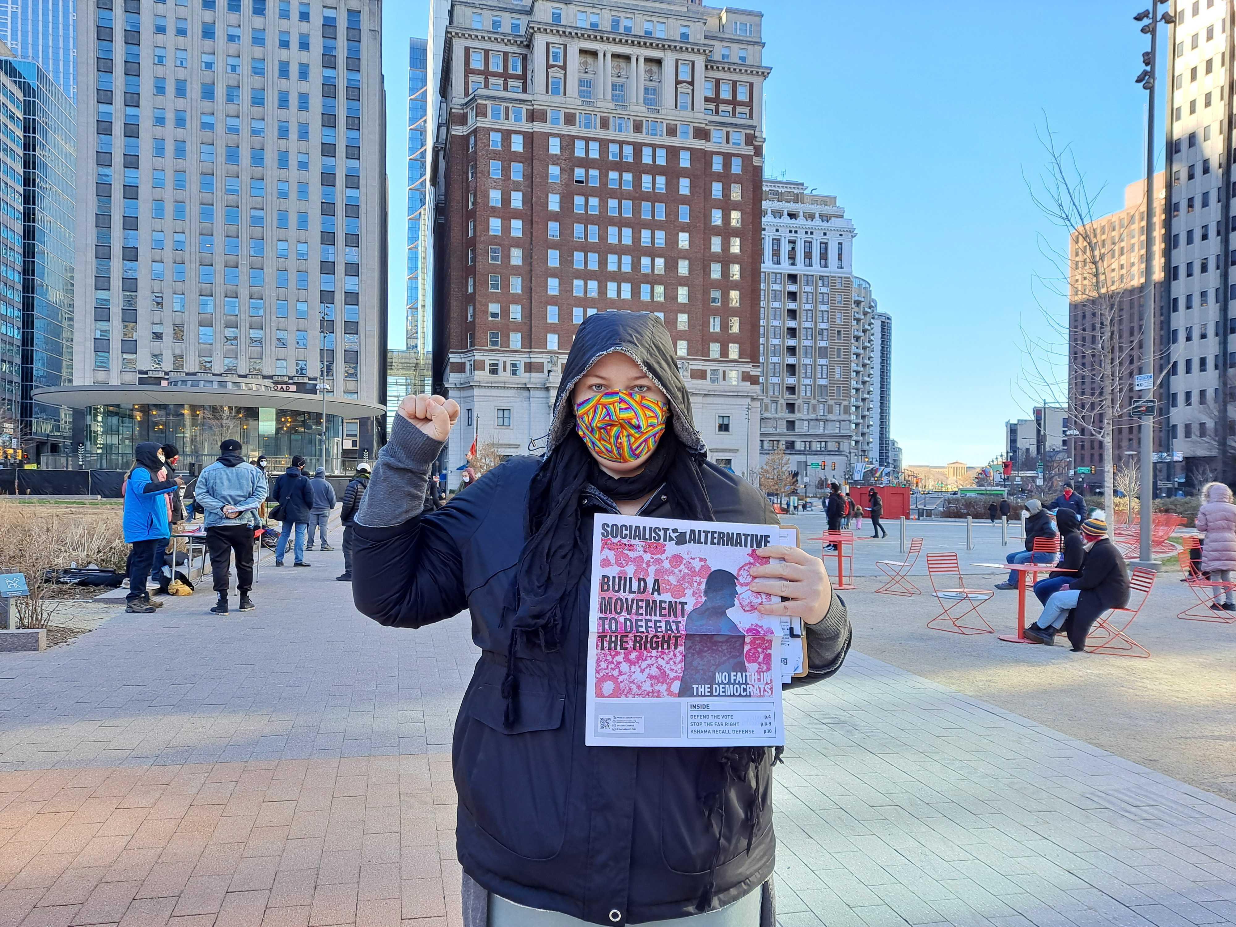 Nat Dekok stands outside near City Hall at a Socialist Alternative meeting