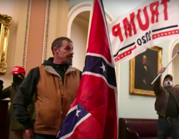 Kevin Seefried carries a Confederate flag inside the U.S. Capitol