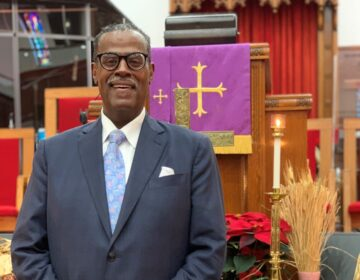 Rev. Silvester Beaman stands inside Wilmington's Bethel African Methodist Episcopal Church