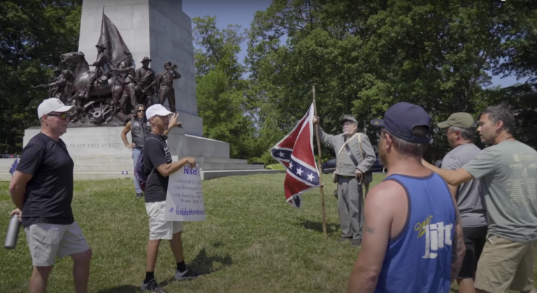 Scott Hancock speaks in front of the Virginia monument in this still from the upcoming documentary